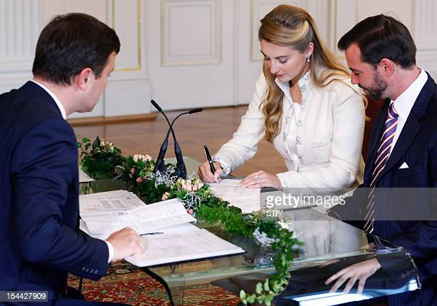 Prince Guillaume, heir to the thrown of Luxembourg, and Belgium's Countess Stephanie de Lannoy sign documents during their civil wedding, on October...