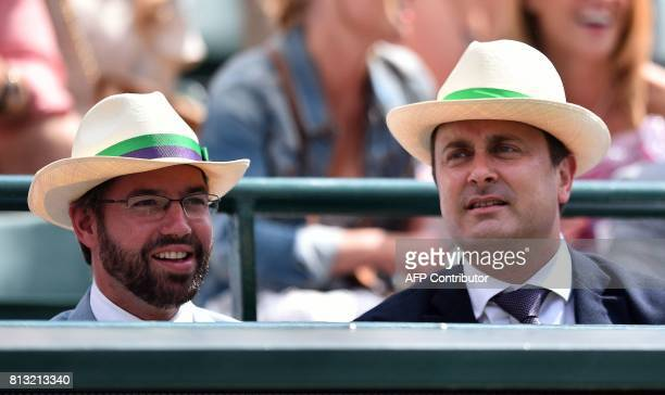 Prince Guillaume Hereditary Grand Duke of Luxembourg and Luxembourg's Prime Minister Xavier Bettel wear sun hats as they watch Luxembourg's Gilles...
