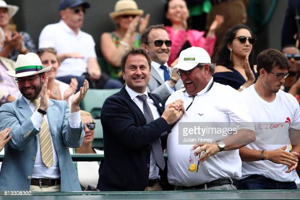 Prince Guillaume of Luxembourg and Luxembourg's Prime Minister Xavier Bettel celebrate during the Gentlemen's Singles quarter final match between...