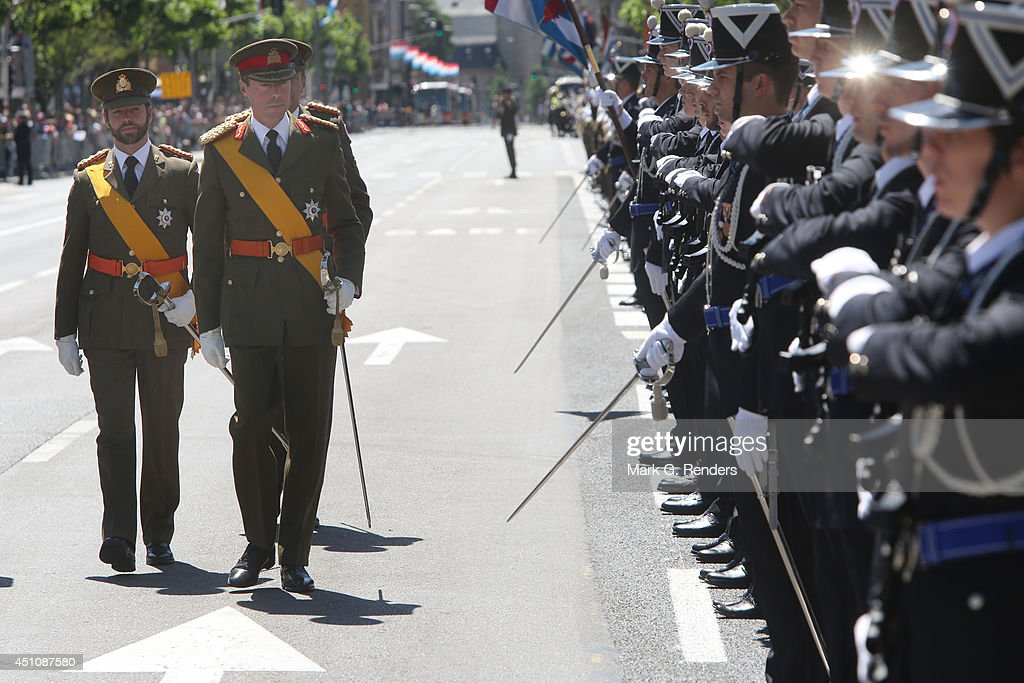 Prince Guillome and Grand Duke Henri of Luxembourg celebrate National Day during the parade on June 23, 2014 in Luxembourg, Luxembourg.