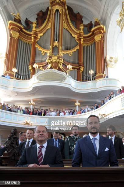 Prince Haakon of Norway and Hamburgs First Major Olaf Scholz visit the Michel Church on May 6 2011 in Hamburg Germany Prince Haakon of Norway visits...