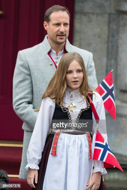 Prince Haakon of Norway Princess Ingrid Alexandra of Norway greet the children in the parade at their home Skaugum on Norway's National Day on May 17...