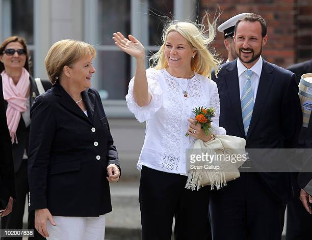 Prince Haakon of Norway, Princess Mette-Marit of Norway and German Chancellor Angela Merkel arrive at the main square on June 12, 2010 in Stralsund,...