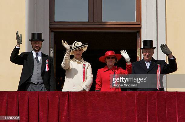 Prince Haakon of Norway Princess MetteMarit of Norway Queen Sonja of Norway and King Harald V of Norway wave from the balcony of the Royal Palace...