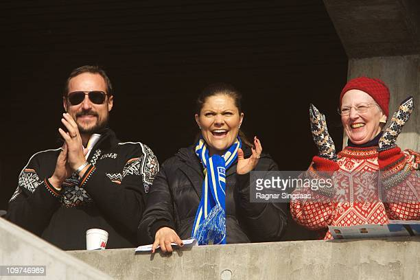 Prince Haakon of Norway Princess Victoria of Sweden and Queen Margrethe II of Denmark attend the Ladies Relay 4x5km Classic/Free race during the FIS...