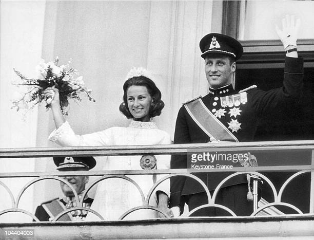 Prince HARALD and Princess SONJA greeting the crowd upon their wedding from the Royal Palace's balcony in Oslo Norway
