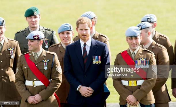 Prince Harry after presenting 12 pilots from Course 17/02 of the Army Air Corps with their Wings during a ceremony at Museum of Army Flying on March...