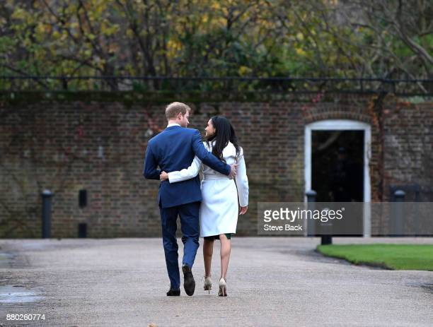 Prince Harry and actress Meghan Markle attend an official photocall to announce their engagement at The Sunken Gardens at Kensington Palace on...