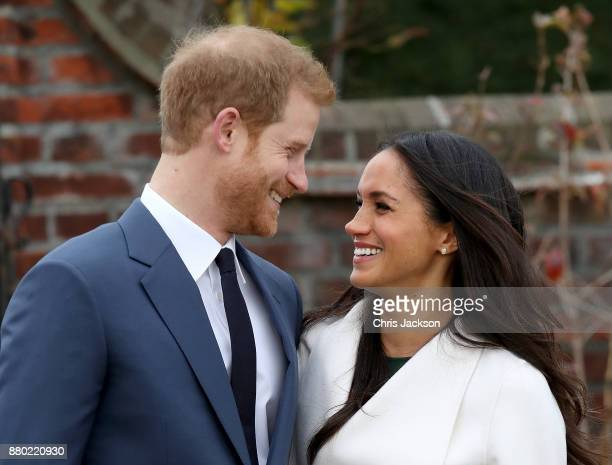 Prince Harry and actress Meghan Markle during an official photocall to announce their engagement at The Sunken Gardens at Kensington Palace on...