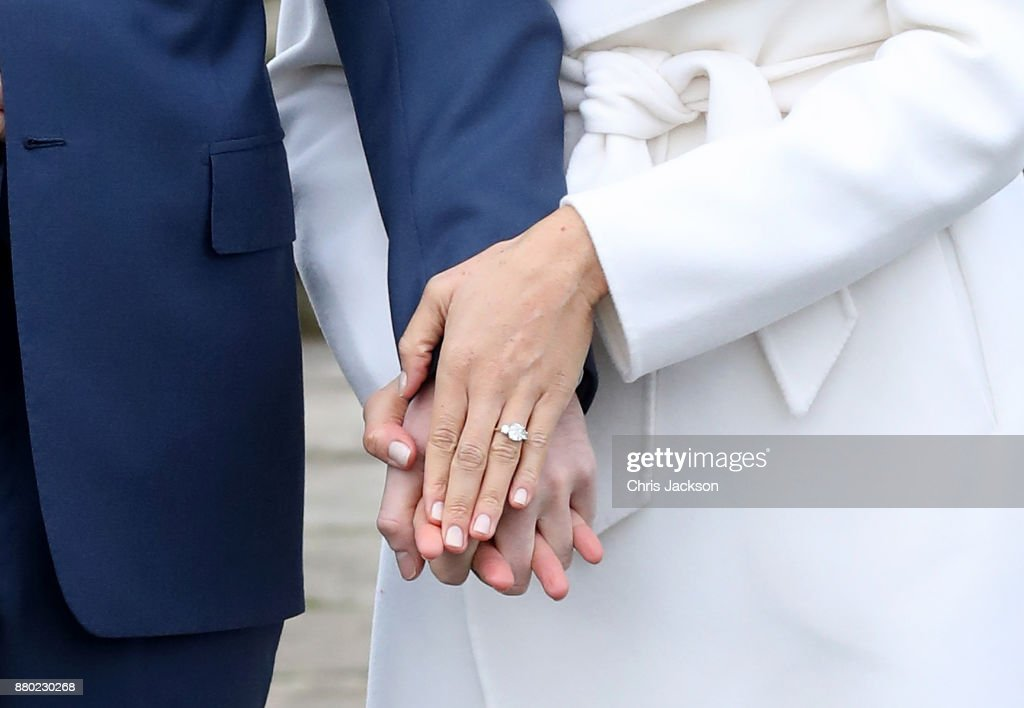 The Ring - it was designed by Prince Harry, with a gold band (Meghan's favourite), a diamond from Botswana and little diamonds from Princess Diana's jewellery collection.