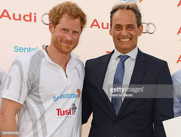 Prince Harry and Andre Konsbruck Director of Audi UK attend day one of the Audi Polo Challenge at Coworth Park on May 28 2016 in London England
