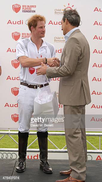 Prince Harry and Andre Konsbruck Director of Audi UK attend day two of the Audi Polo Challenge at Coworth Park on May 31 2015 in London England