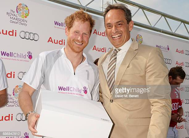 Prince Harry and Andre Konsbruck Director of Audi UK attend day two of the Audi Polo Challenge at Coworth Park on May 29 2016 in London England