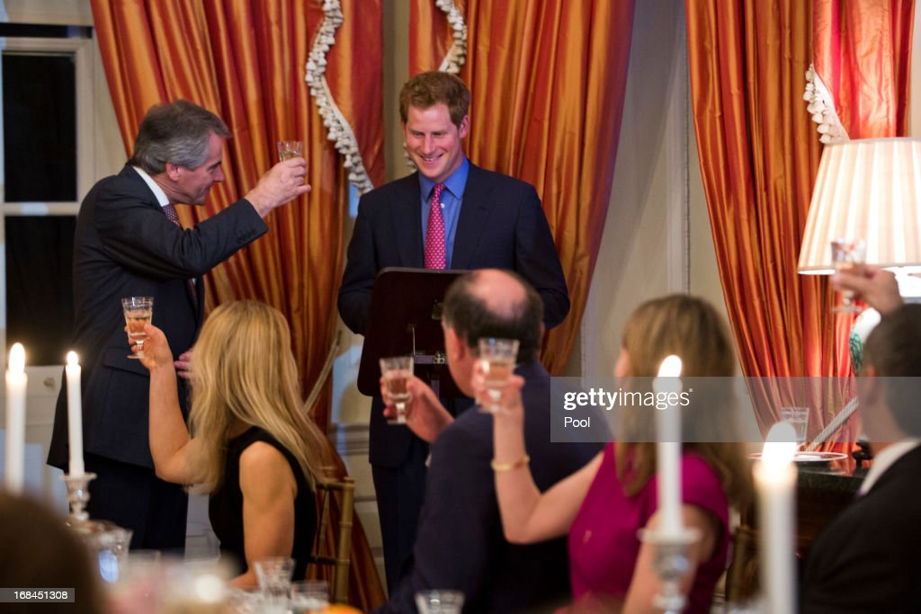 Prince Harry (R) and British Ambassador Sir Peter Westmacott (L) speak at a dinner at the British Ambassador's residence on May 9, 2013 in Washington, DC.