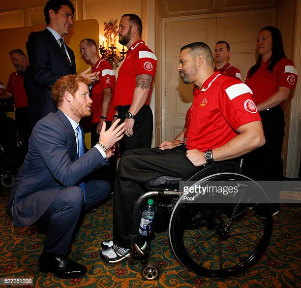 Prince Harry and Canadian Prime Minister Justin Trudeau meet members of the Canadian Invictus Games 2016 team at the Royal York Hotel on May 2 2016...