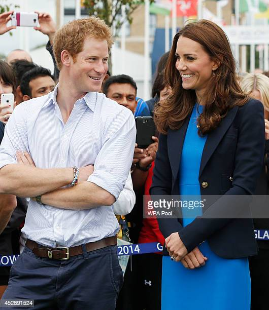 Prince Harry and Catherine Duchess of Cambridge chat during a visit to the Commonwealth Games Village on July 29 2014 in Glasgow Scotland