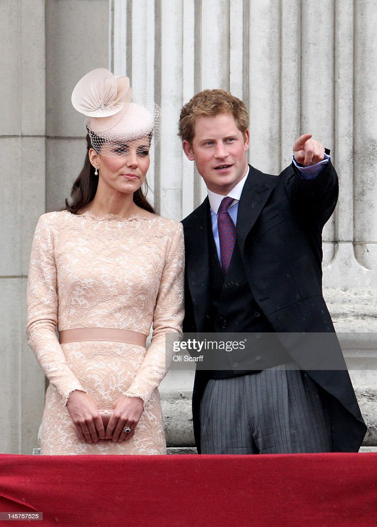 Prince Harry and Catherine, Duchess of Cambridge on the balcony of Buckingham Palace after the service of thanksgiving at St.Paul's Cathedral on June 5, 2012 in London, England. For only the second time in its history the UK celebrates the Diamond Jubilee of a monarch. Her Majesty Queen Elizabeth II celebrates the 60th anniversary of her ascension to the throne. Thousands of wellwishers from around the world have flocked to London to witness the spectacle of the weekend's celebrations.