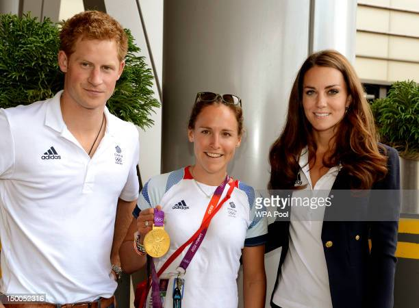 Prince Harry and Catherine Duchess of Cambridge pose with Gold medal winning rower Sophie Hosking at Team GB House in the Westfield Centre on Day 13...