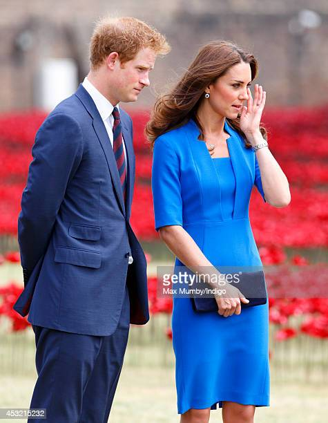 Prince Harry and Catherine Duchess of Cambridge visit the poppy field art installation entitled 'Blood Swept Lands and Seas of Red' by artist Paul...