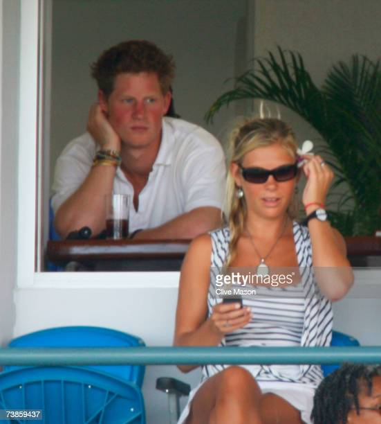 Prince Harry and Chelsy Davy look on during the ICC Cricket World Cup Super Eights match between England and Bangladesh at the Kensington Oval on...