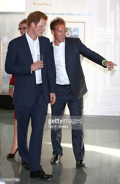 Prince Harry and Chris Jackson attend the private view of 'Sentebale - Stories Of Hope' at Getty Images Gallery on July 25, 2013 in London, England....