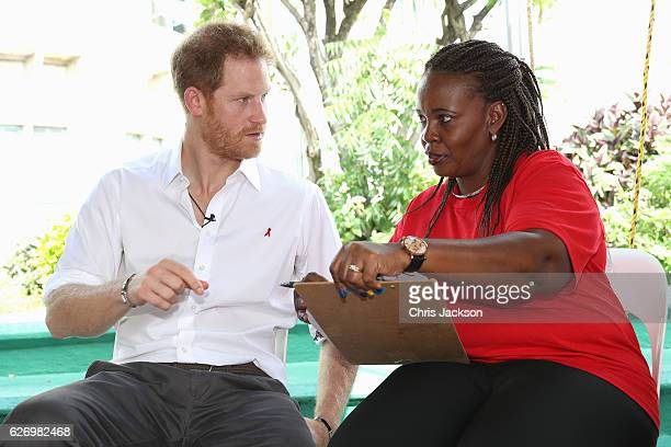 Prince Harry and councillor Ministry of Health HIV Program Susette NeblettStraughn talk in preparation of an live HIV test in order to promote more...