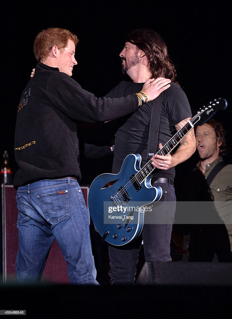 Prince Harry and Dave Grohl from the Foo Fighters attend the Invictus Games closing ceremony at Queen Elizabeth Olympic Park on September 14, 2014 in London, England.