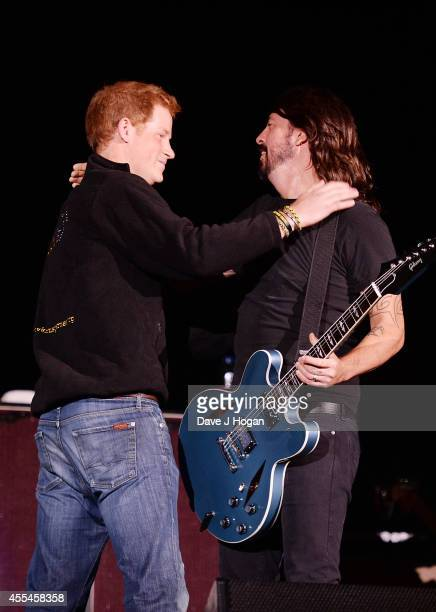 Prince Harry and Dave Grohl on stage at The Jaguar Land Rover Invictus Games Closing Concert at Olympic Park on September 14 2014 in London England