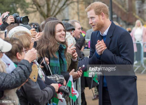 Prince Harry and fiance Meghan Markle during a walkabout at Cardiff Castle on January 18 2018 in Cardiff Wales