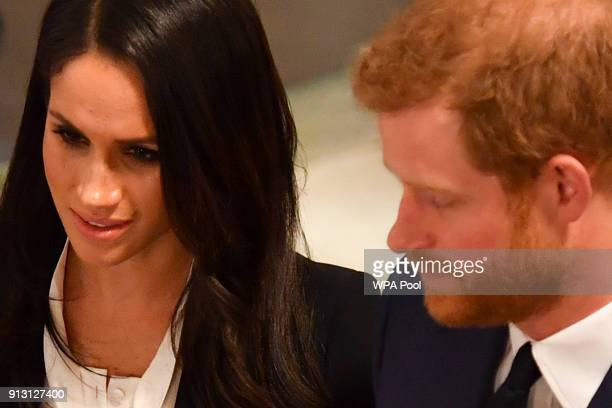 Prince Harry and fiance Meghan Markle greet guests as they attend the 'Endeavour Fund Awards' Ceremony at Goldsmiths Hall on February 1 2018 in...