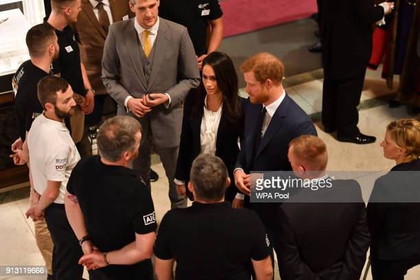 Prince Harry and fiance Meghan Markle greet guests during a preceremony reception as they attend the 'Endeavour Fund Awards' Ceremony at Goldsmiths...