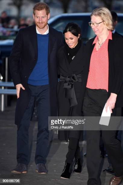 Prince Harry and fiancee Meghan Markle arrive for their visit to Star Hub on January 18 2018 in Cardiff Wales