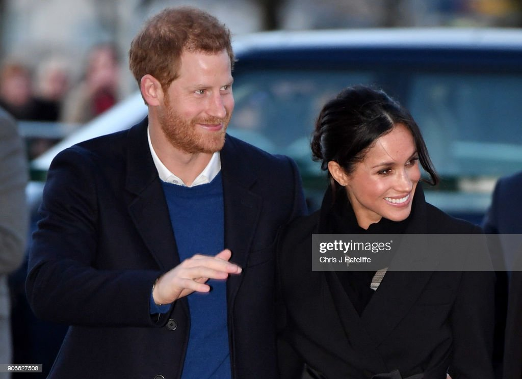 Prince Harry (L) and fiancee Meghan Markle arrive for their visit to Star Hub on January 18, 2018 in Cardiff, Wales.
