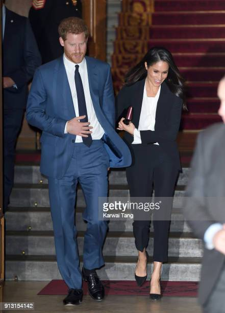 Prince Harry and fiancee Meghan Markle depart after attending the 'Endeavour Fund Awards' Ceremony at Goldsmiths' Hall on February 1 2018 in London...