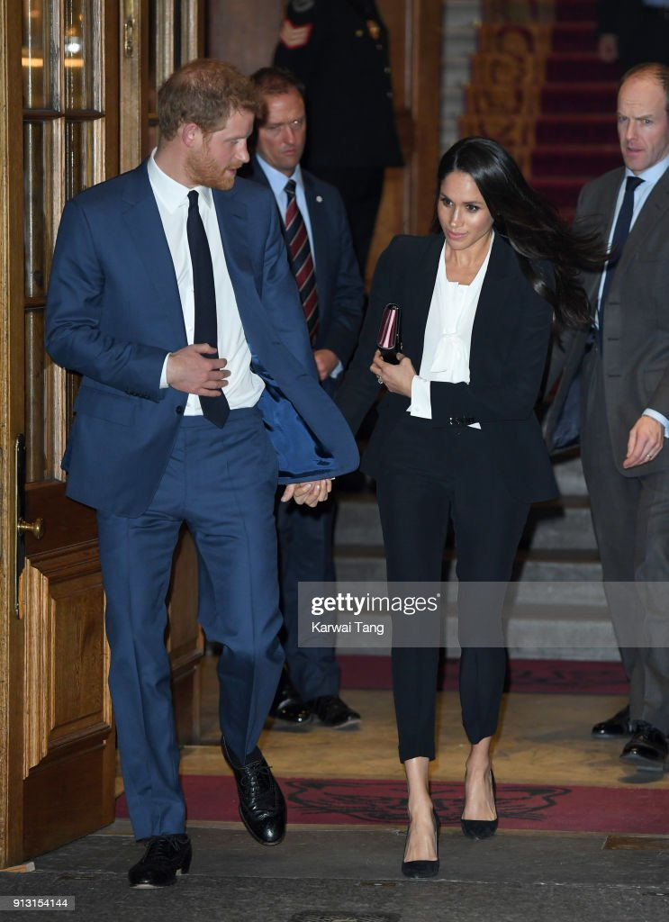 Prince Harry and fiancee Meghan Markle depart after attending the 'Endeavour Fund Awards' Ceremony at Goldsmiths' Hall on February 1, 2018 in London, England. The awards celebrate the achievements of wounded, injured and sick servicemen and women who have taken part in remarkable sporting and adventure challenges over the last year.