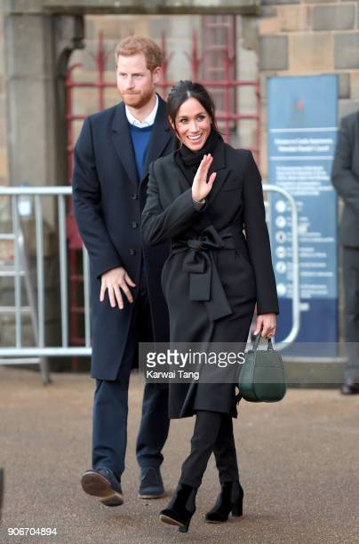 Prince Harry and fiancee Meghan Markle during a walkabout at Cardiff Castle on January 18 2018 in Cardiff Wales