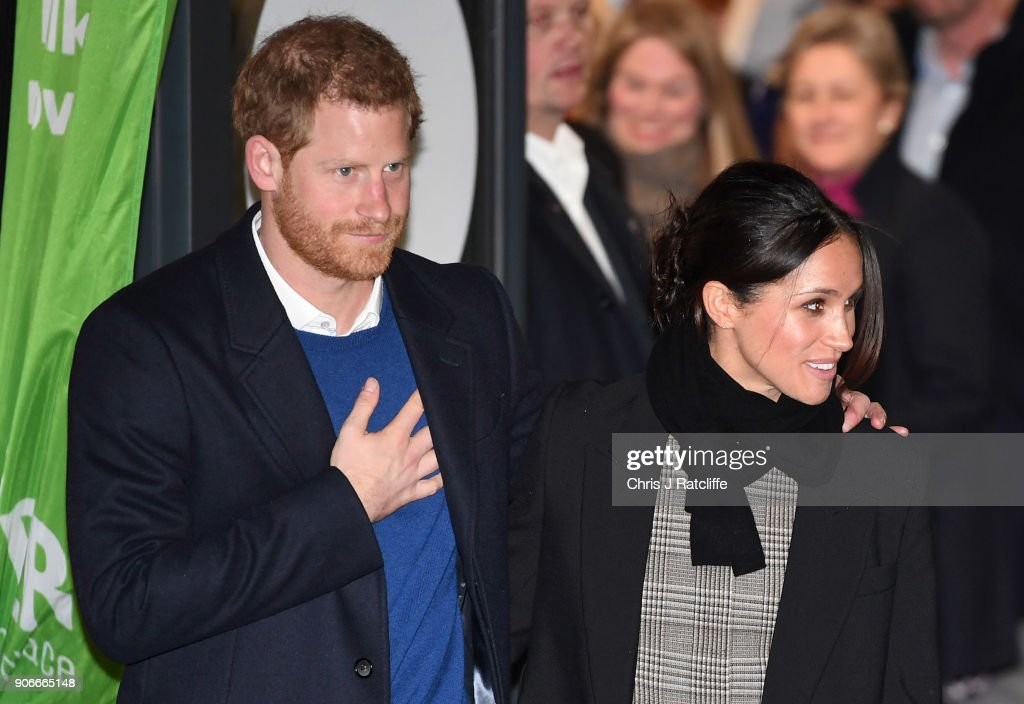 Prince Harry (L) and fiancee Meghan Markle leave after their visit to Star Hub on January 18, 2018 in Cardiff, Wales.
