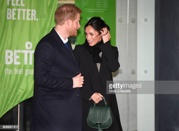 Prince Harry and fiancee Meghan Markle leave after their visit to Star Hub on January 18 2018 in Cardiff Wales