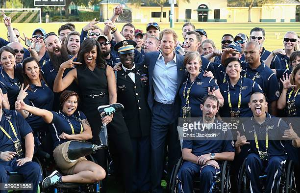 Prince Harry and First Lady Michelle Obama meet the USA Invictus Team ahead of the Opening Ceremony of the Invictus Games Orlando 2016 at ESPN Wide...