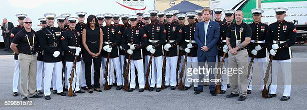 Prince Harry and First Lady Michelle Obama pose with the US Marine Corps Silent Drill Platoon ahead of the Opening Ceremony of the Invictus Games...