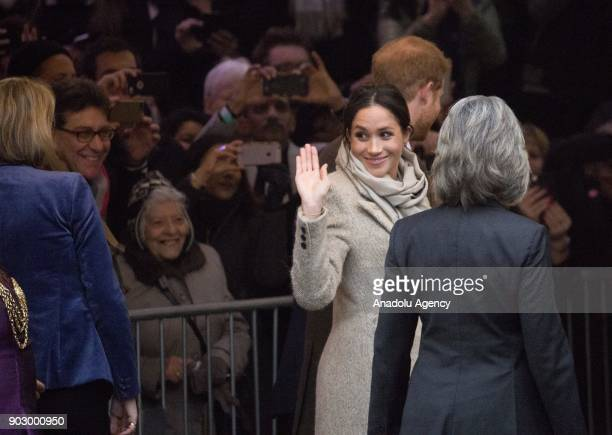 Prince Harry and his fiance Meghan Markle greet the crowd as they arrive Pop Brixton to see the broadcaster's work supporting young people through...