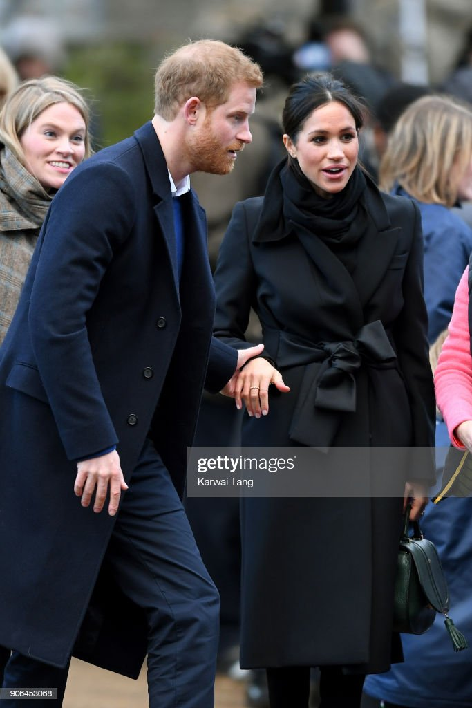 Prince Harry and his fiancee Meghan Markle are seen during a walkabout at Cardiff Castle on January 18, 2018 in Cardiff, Wales.