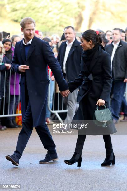 Prince Harry and his fiancee Meghan Markle are seen during a walkabout at Cardiff Castle on January 18 2018 in Cardiff Wales