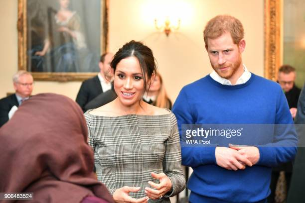 Prince Harry and his fiancee Meghan Markle at a reception during their visit to Cardiff Castle on January 18 2018 in Cardiff Wales