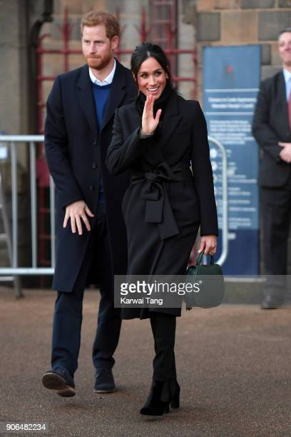 Prince Harry and his fiancee Meghan Markle depart from a walkabout at Cardiff Castle on January 18 2018 in Cardiff Wales