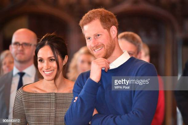 Prince Harry and his fiancee Meghan Markle watch a performace during their visit to Cardiff Castle on January 18 2018 in Cardiff Wales