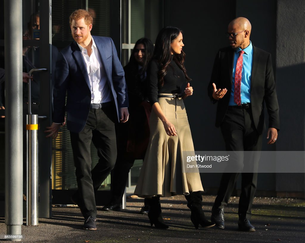 Prince Harry and his fiancee, US actress Meghan Markle, depart Nottingham Academy as part of their first official public engagements together on December 1, 2017 in Nottingham, England. Prince Harry and Meghan Markle announced their engagement on Monday 27th November 2017 and will marry at St George's Chapel, Windsor in May 2018.