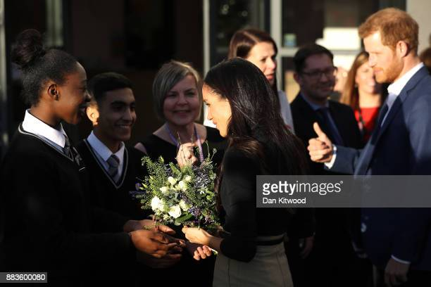 Prince Harry and his fiancee US actress Meghan Markle depart Nottingham Academy as part of their first official public engagements together on...