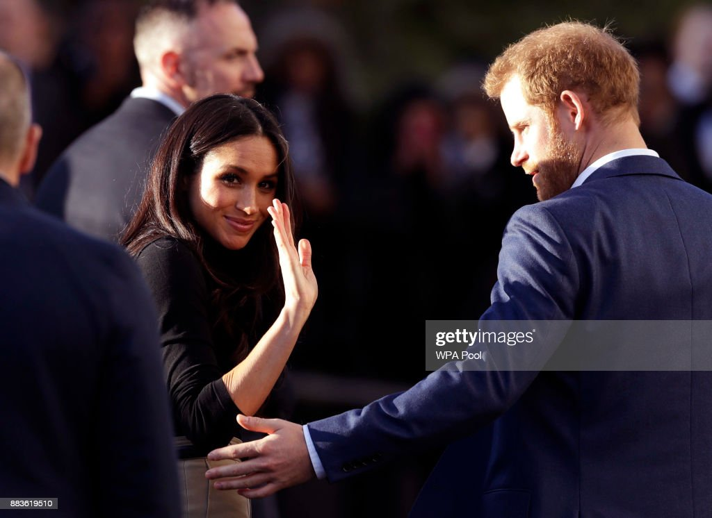 Prince Harry and his fiancee US actress Meghan Markle leave after watching a hip hop opera performed by young people involved in the Full Effect programme at the Nottingham Academy school on December 1, 2017 in Nottingham, England. Prince Harry and Meghan Markle announced their engagement on Monday 27th November 2017 and will marry at St George's Chapel, Windsor in May 2018.