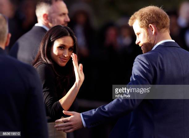 Prince Harry and his fiancee US actress Meghan Markle leave after watching a hip hop opera performed by young people involved in the Full Effect...